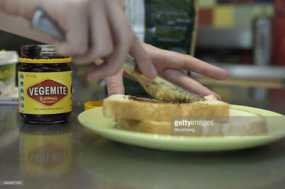 A consumer applies Vegemite spread to a piece of toast in an arranged photograph in Melbourne, Australia, on Thursday Jan. 19, 2017. Bega Cheese Ltd., who has acquired Vegemite as part of a record A$460 million ($345 million) deal, is also acquiring the license to sell Kraft Peanut Butter and processed cheese. Photographer: Carla Gottgens/Bloomberg